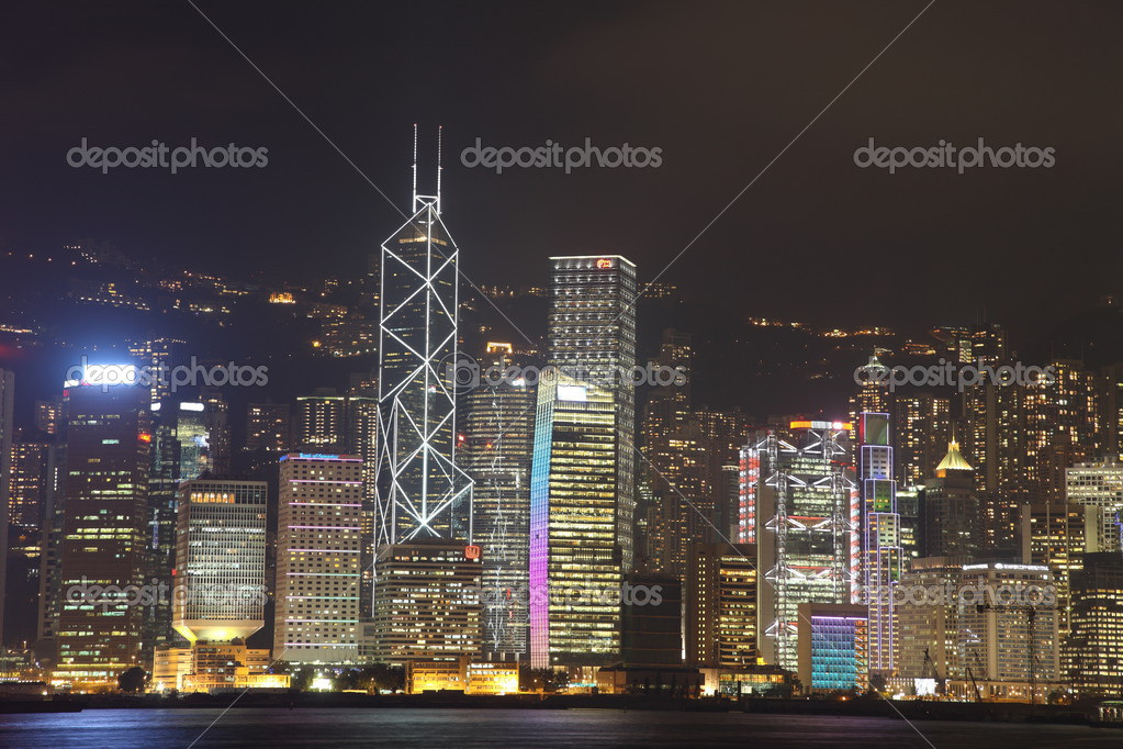 Illuminated Hong Kong Island skyline with reflections at night  Stock Photo #2935752