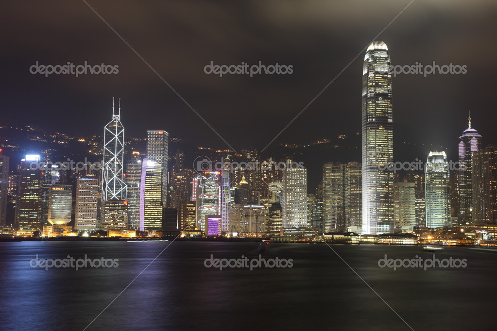 Illuminated Hong Kong Island skyline with reflections at night — Stok fotoğraf #2935791