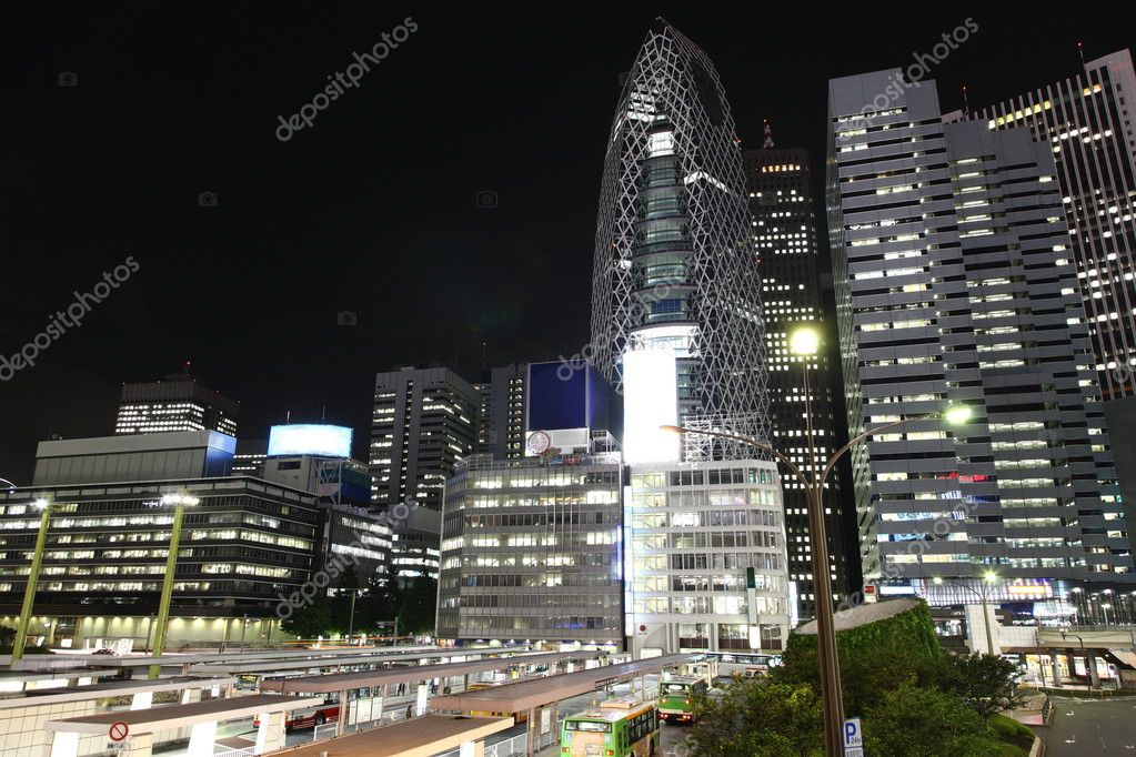 Tokyo streets, bus station and skyscrapers at night from high above — Stock Photo #3635090