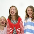 Three sisters laughing — Stock Photo