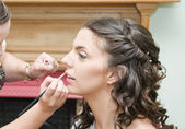 Bride having makeup applied — Stock Photo