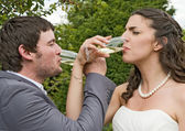 Bride and Groom Celebrating with a glass of Champagne — Stock Photo