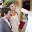 Bride and Groom at alter — Stock Photo #3493181