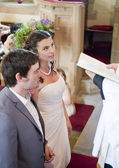Bride and Groom at the alter — Stock Photo