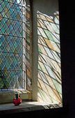 Light shining through a stained glass window — Stock Photo
