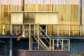 Detail of an industrial building with colorful patina — Stock Photo