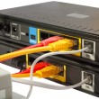 Stock Photo: Wireless Routers and Networking Cable