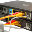 Wireless Routers and Networking Cable - Stock Photo