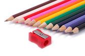 Pencil Sharpener and crayons — Stock Photo