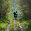 Mountain biker on rural road — Stock Photo #2694955