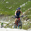Bike uphill on high mountain road — Stock Photo