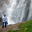Man and great waterfall — Stock Photo #2695832