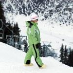 Woman on mountain ski resort slope — Stock Photo