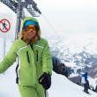 Woman on mountain ski resort slope — Stock Photo