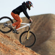 Girl downhill on bike — Stock Photo