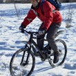 Smiling snow biker — Stock Photo