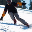 Fast mountain skier downhill on ski resort slope — Foto de Stock