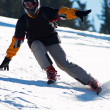 Fast mountain skier downhill on ski resort slope — ストック写真