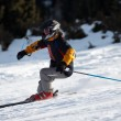 Stock Photo: Fast mountain skier downhill on ski resort slope