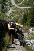 Biker uphill along pipe — Stock Photo