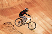 Extreme biker in red canyon — Stock Photo