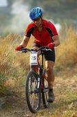 Mountain biker on race — Stock Photo