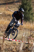 Black biker on race — Stock Photo
