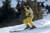 Yellow mountain skier — Stock Photo