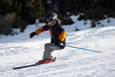 Fast mountain skier downhill on ski resort slope — Stock Photo