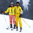 Yong family skiers in yellow on ski slope — Foto de Stock
