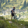 Biker in mountain - Stock Photo