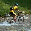 Stock Photo: Mountain biker and creek