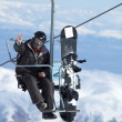 Snowboarder on lift - Stock Photo