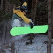 Flying Snowboarder on green board — Stock Photo #2707282
