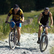 Two bikers on high mountain road — Stock Photo