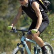 Young mountain biker - Foto Stock