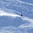 Mountain-skier on flank of hill — Stock Photo