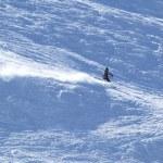 Mountain-skier on flank of hill — Stock Photo