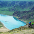 Adventure mountain biking on riverside - Stock Photo
