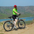 Постер, плакат: Adventure mountain biking on riverside