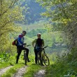 Man and woman on bike — Stock Photo