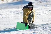 Snowboarder sits on slope in expectation of — Stock Photo