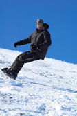 Snowboarder and blue sky — Stock Photo