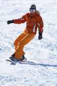 Orange snowboard girl downhill — Stock Photo