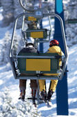 Two skiers on elevator — Stock Photo