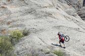Mountain biker uphill — Stock Photo