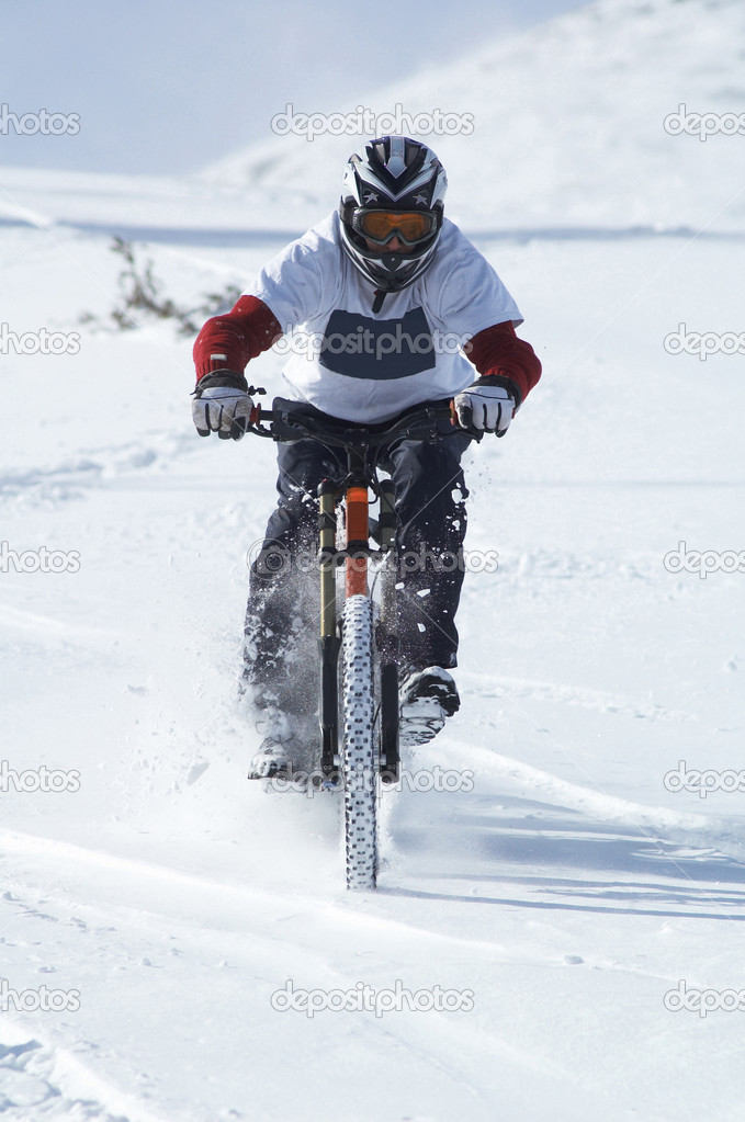 Snow biker downhill  Stock Photo #2707161