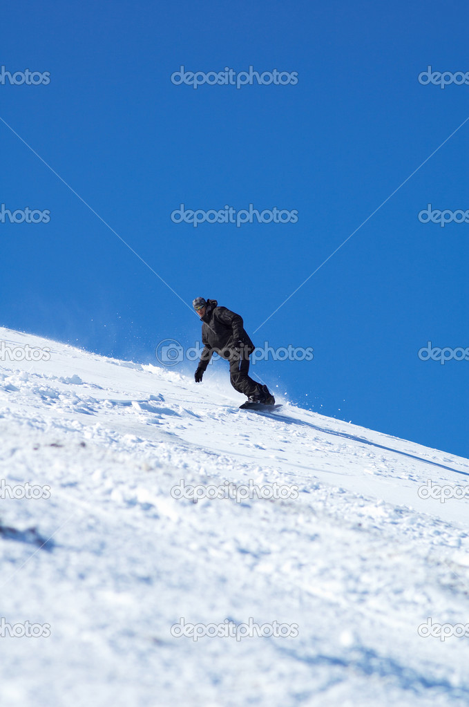 Black snowboarder and blue sky — Stock fotografie #2707541