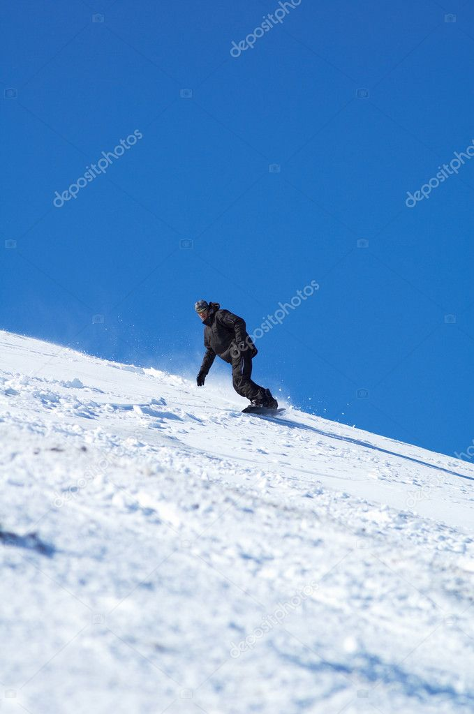 Black snowboarder and blue sky — Stock Photo #2707541