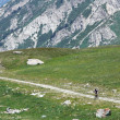 Biker on high mountain rural road - Foto Stock